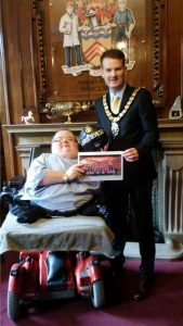 Richard presenting Cllr Rhys Lewis, Mayor of Rhondda Cynon Taff with the ball