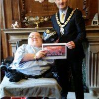 Richard presenting Cllr Rhys Lewis, Mayor of Rhondda Cynon Taff with the ball