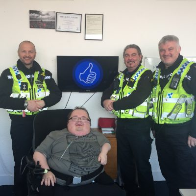 Accessible News founder Richard Jones with Inspector Robert Blunt, PCSO Ceri Price and PC Nick James