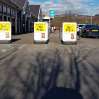 Three Cyclone Bollards obstructing the dropped kerb in Tesco Aberdare