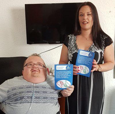 Founder Richard Jones and Vikki Howells AM showing a Considerate Parking leaflet