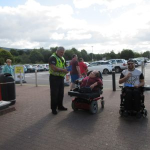 Founder Richard Jones, PC Nicholas James and a member of Rhondda Cynon Taf Disability Forum meeting shoppers in Aberdare