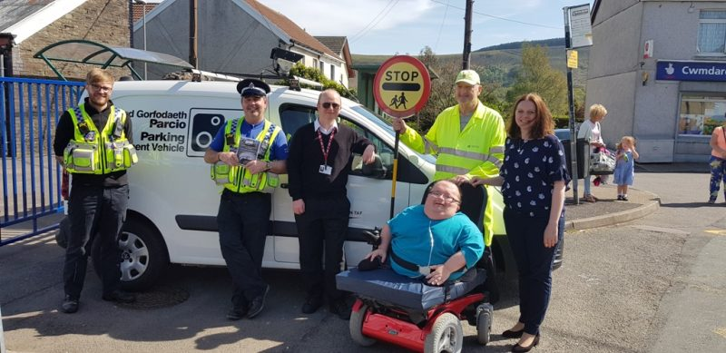 This image is of the team involved in the Day of Action outside Cwmdare Primary School. The picture consists of PCSO's Toomey and Price, RCT Parking Enforcement Officer, Accessible News founder Richard Jones, Mrs Evans (Head Teacher) and Simon the school's crossing patrol person.