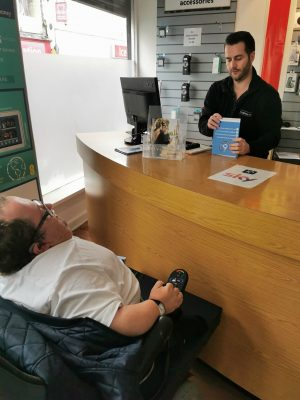 Accessible News founder Richard Jones discussing the Considerate Parking Campaign with Fonehouse Store Manager Robert George