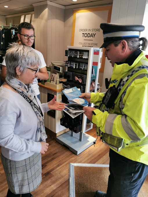 PCSO Ceri Price talking to shoppers in Aberdare about the Considerate Parking Campaign